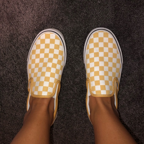 yellow checkered vans on feet